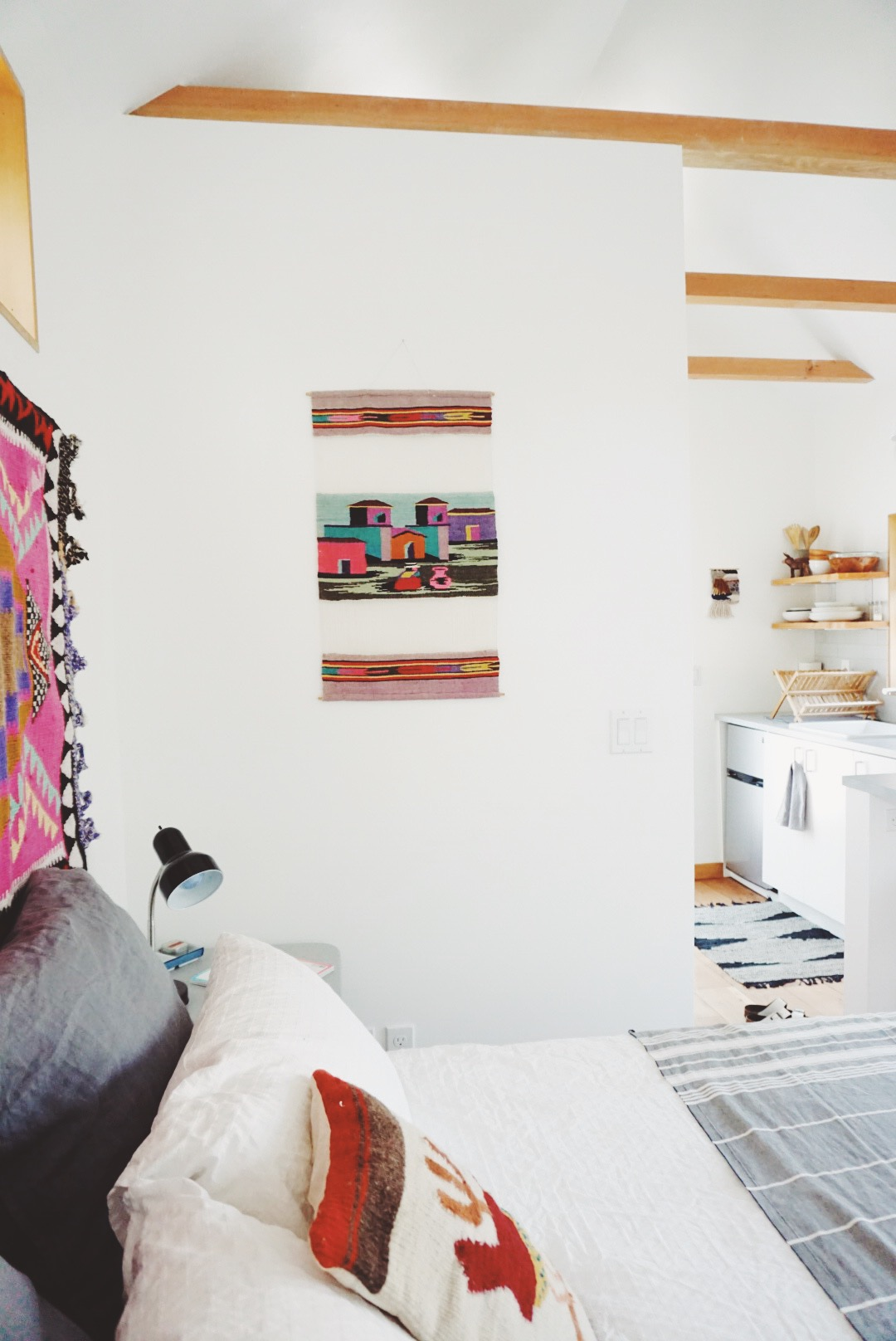 a cozy room in a tiny house designed by Emily Katz