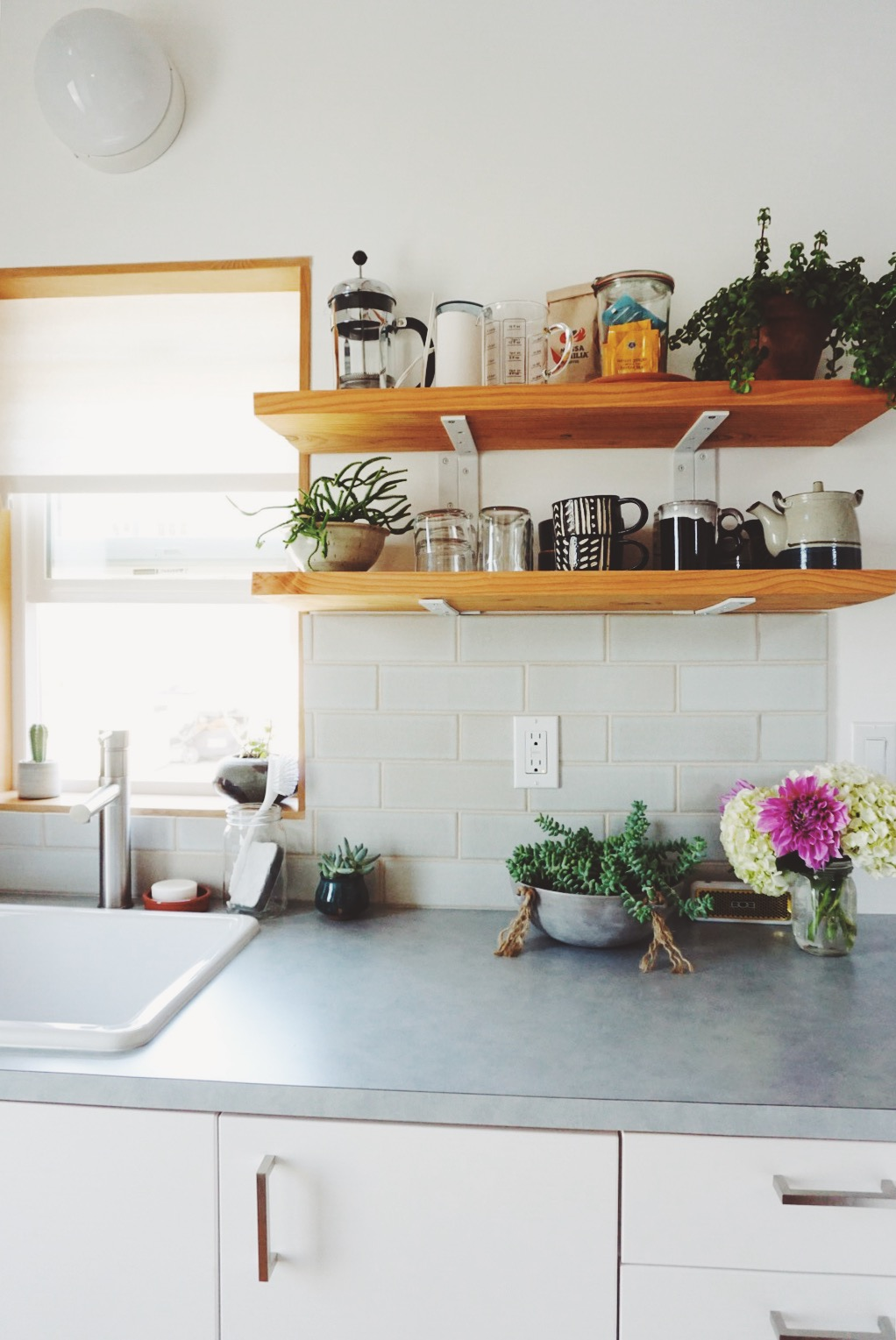 bright scandinavian designed kitchen with floating shelves