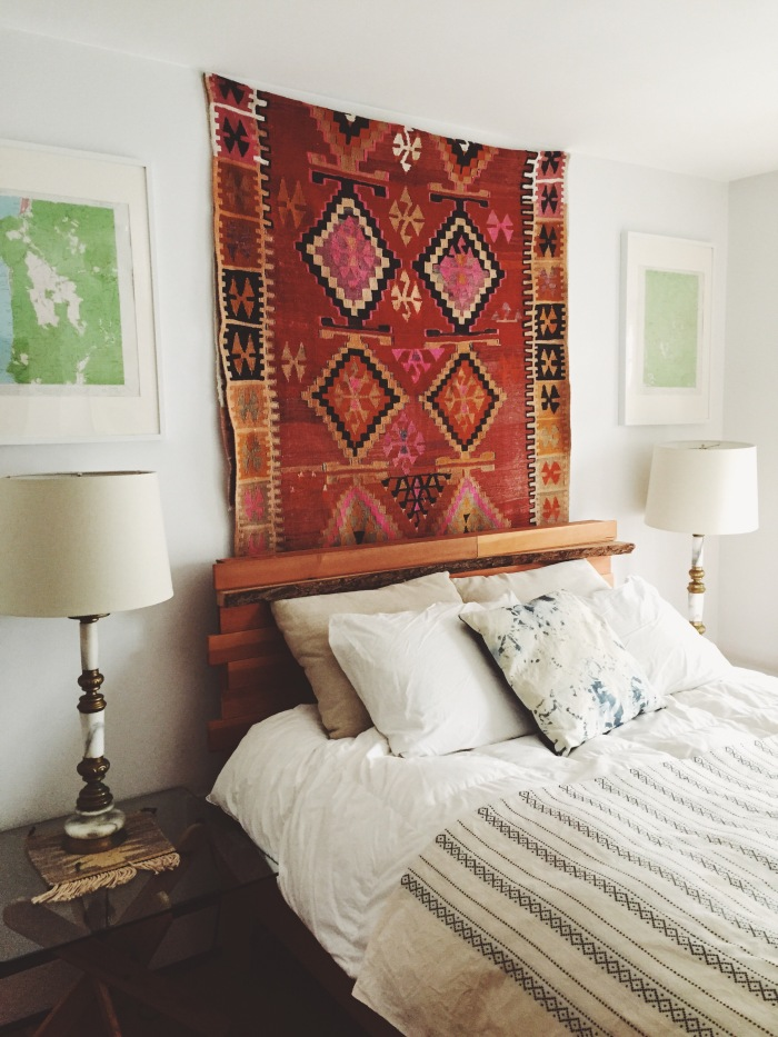 Transform a room by hanging a colorful Kilim rug on the wall above the bed or sofa